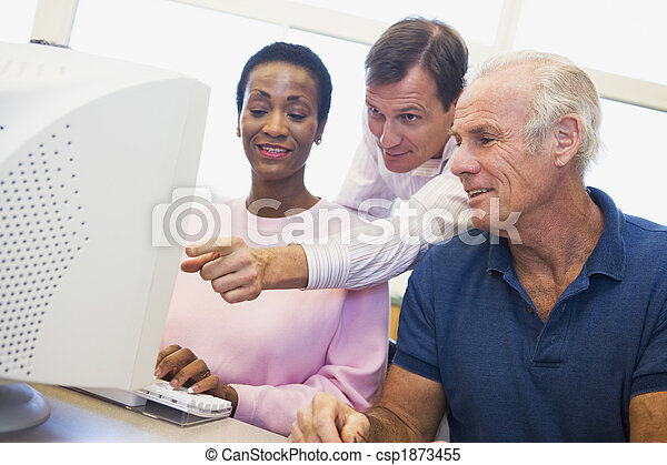 Mature students learning computer skills - csp1873455