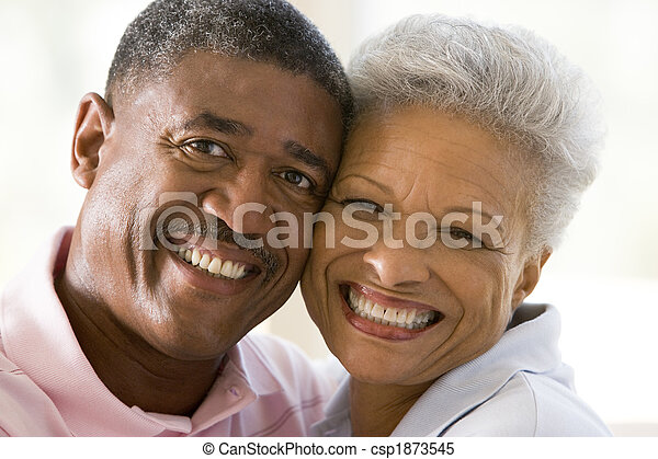 Couple relaxing indoors and smiling - csp1873545