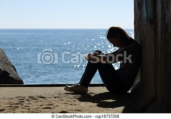 Teen girl lonely and sadness on the beach - csp18737258