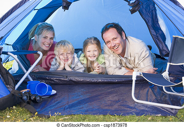Family camping in tent smiling - csp1873978
