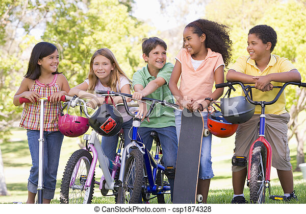 Five young friends with bicycles scooters and skateboard outdoor - csp1874328