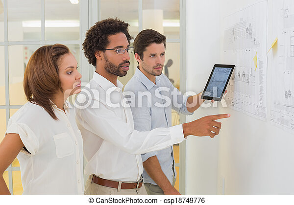 Business people using digital tablet in meeting at office - csp18749776