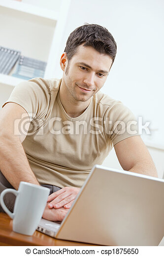 Happy man using computer - csp1875650