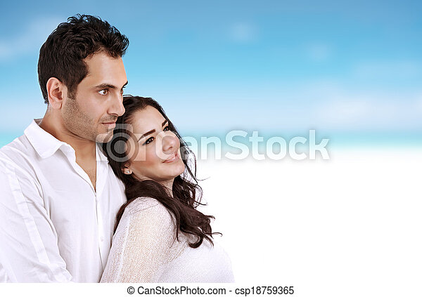 Closeup portrait of beautiful woman with handsome man spending time on the beach, honeymoon vacation, summer holidays concept