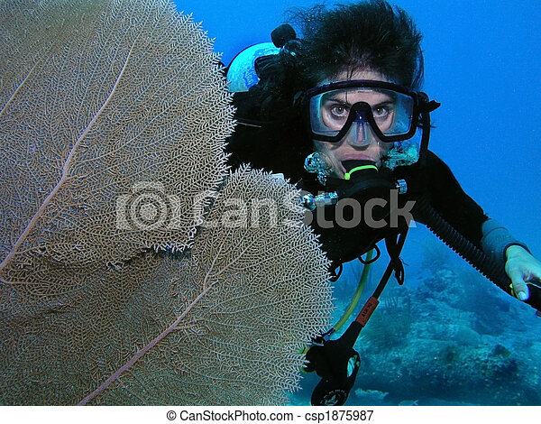 Scuba diver by coral fan - csp1875987