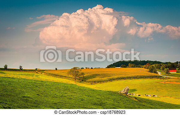 Summer storm cloud over rolling hills and farm fields in rural York County, Pennsylvania. - csp18768923