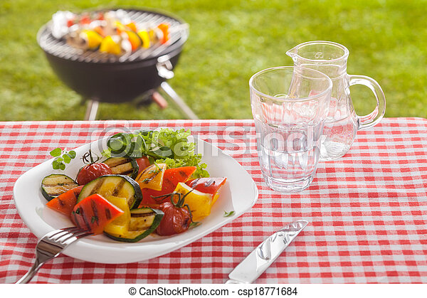 Serving of roast vegetables on a summer picnic - csp18771684