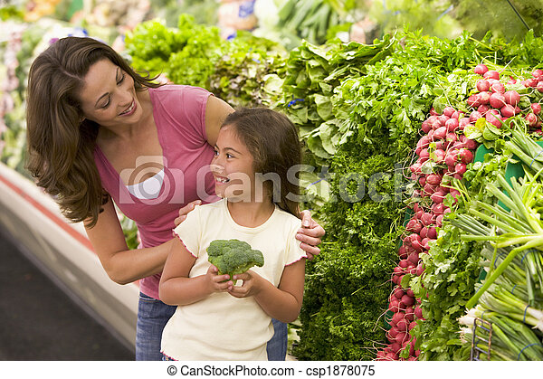 Mother and daughter choosing fresh produce - csp1878075