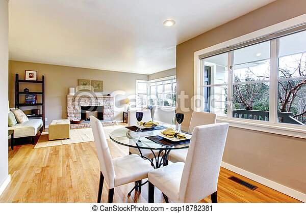 Open design for living and dining room interior. View of the served dining table and living room - csp18782381