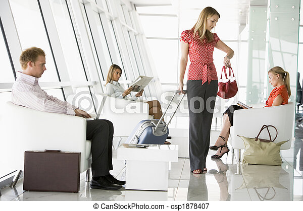 Passengers waiting in airport departure lounge - csp1878407