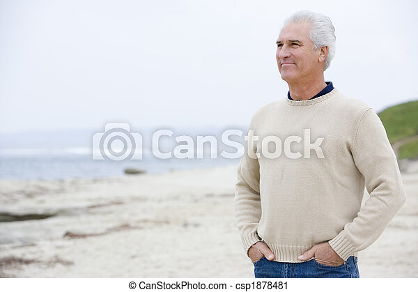 Man at the beach with hands in pockets - csp1878481