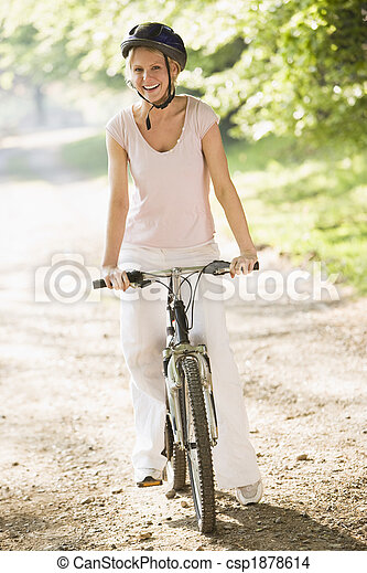 Woman on bicycle smiling - csp1878614