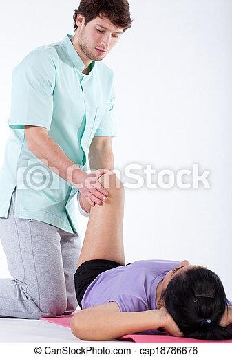 Rehabilitating patient's knee - csp18786676