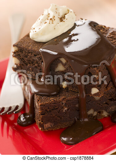 Stack Of Chocolate Brownies With Chocolate Fudge Sauce - csp1878884
