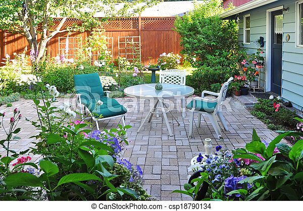View of flower garden and backyard patio area