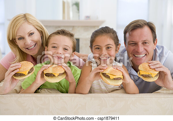 Family Eating Cheeseburgers Together - csp1879411