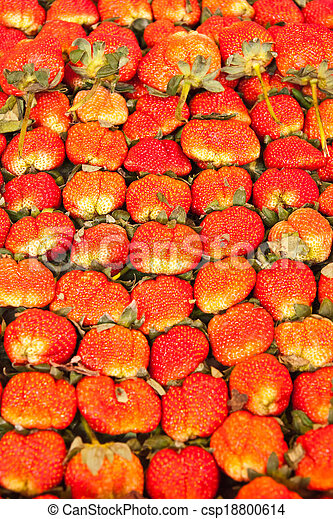 Strawberry with leaf in a basket
