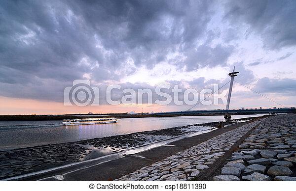 Sunset at Suspension bridges of Kasairinkai park - csp18811390
