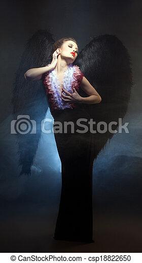 Voluptuous woman posing similitude of fallen angel - csp18822650