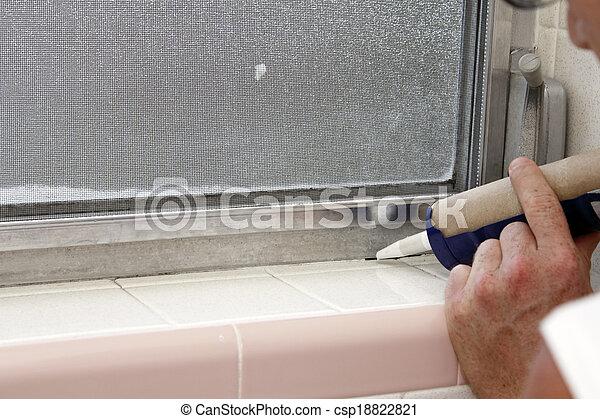 Caulking a Bathroom Window Frame - csp18822821