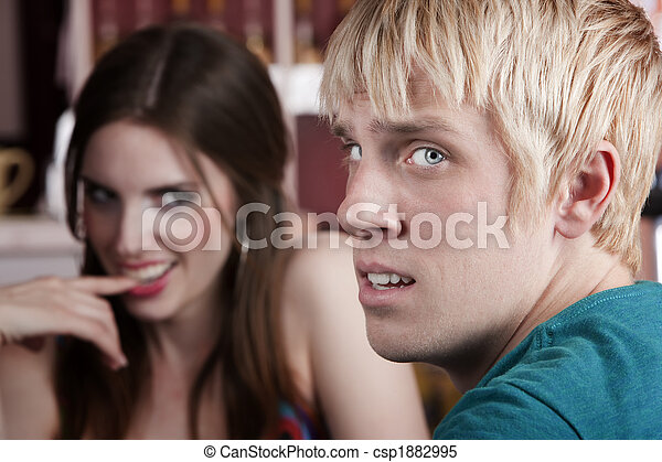 Woman flirting with uninterested male friend - csp1882995