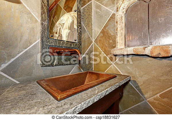 Castle style bathroom. Close up view of copper sink and faucet