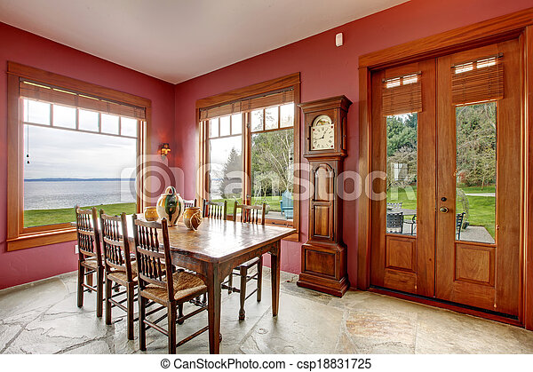 stock photo of burgundy dining room with antique
