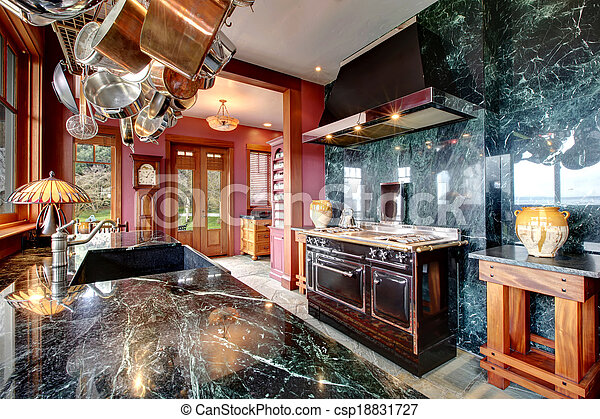 Luxury marble kitchen room with an antique style stove - csp18831727