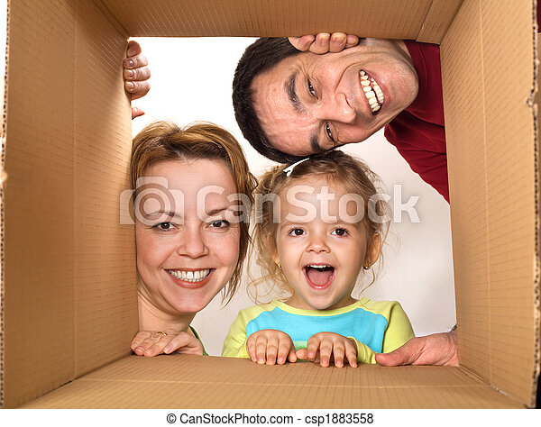 Family opening cardboard box - happy moving concept - csp1883558