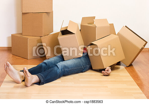 Man covered in cardboard boxes - moving concept - csp1883563