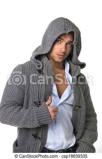 Good looking young man wearing winter hoodie sweater - csp18839335