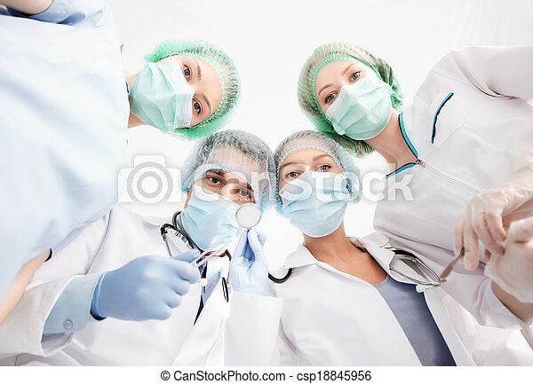 group of doctors in operating room - csp18845956