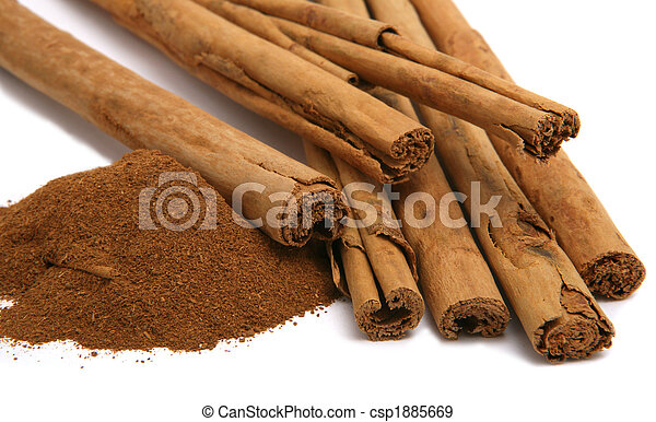 cinnamon powder and bark isolated on white - csp1885669
