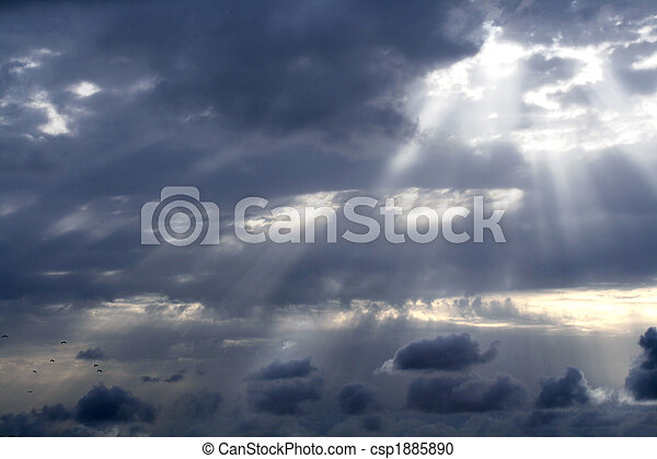 Cloudy stormy sky with sun ray breaking through - csp1885890