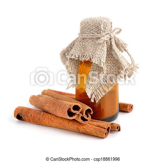 Bark of cinnamon and pharmaceutical bottle. - csp18861996