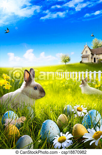 Art Easter bunny rabbit and easter eggs on meadow. - csp18870982