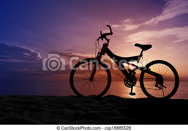 Silhouette of a Bike on the Beach - csp18885528