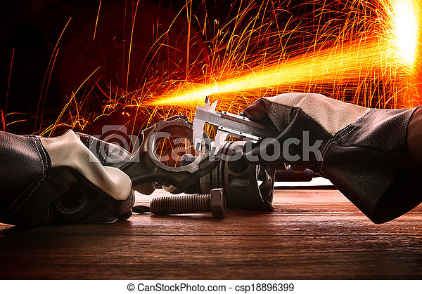 hand of worker man working by leather hand glove protection heat of splashing fire in heavy industry factory use for metal and iron industrial manufacturing theme - csp18896399