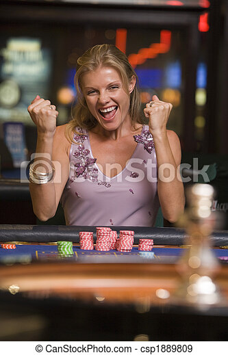 Woman winning  at roulette table - csp1889809
