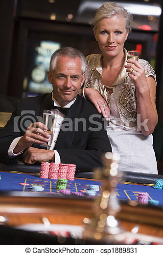 Couple gambling at roulette table - csp1889831