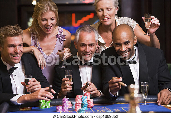 Group of friends gambling at roulette table - csp1889852