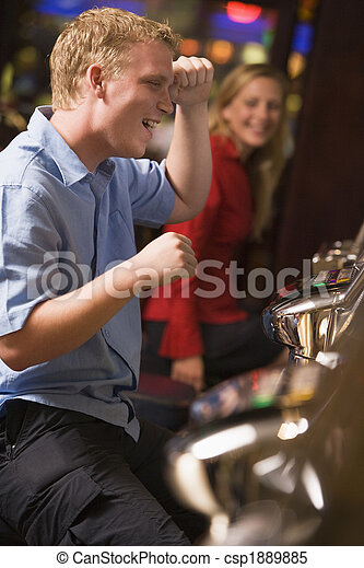 Man celebrating win at slot machine - csp1889885