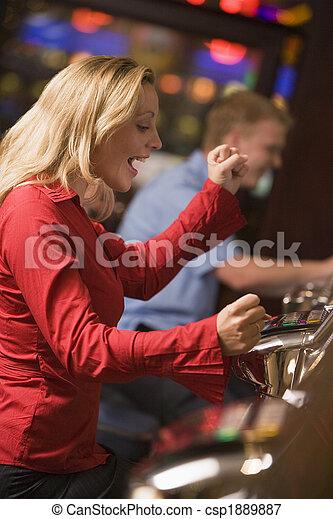 Woman winning on at slot machine - csp1889887