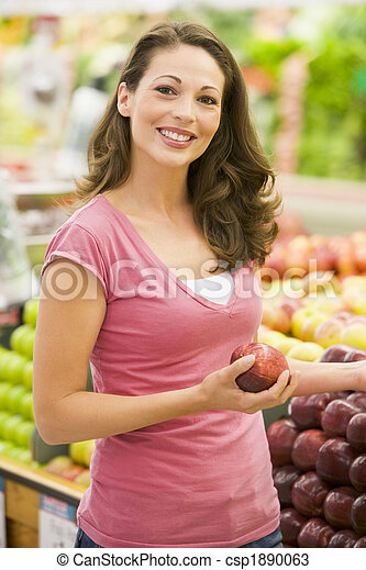 Young woman shopping in produce department - csp1890063