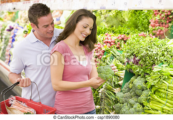 Couple shopping in produce section - csp1890080