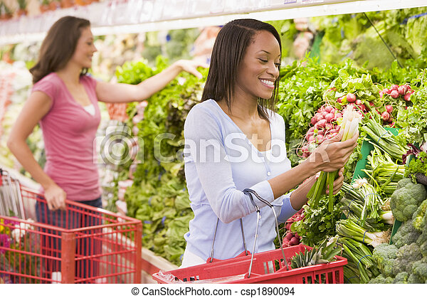 Woman shopping in produce section  - csp1890094