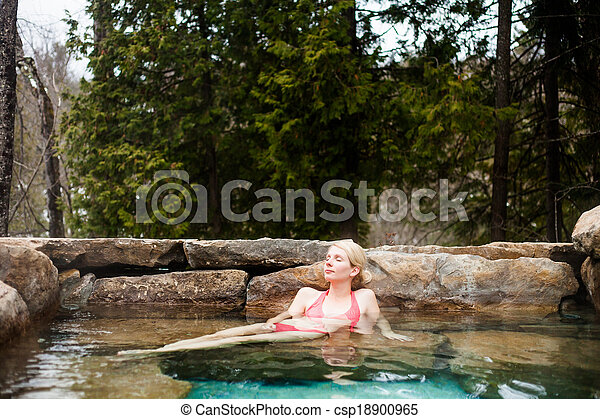 Young Woman Relaxing in a Nordic Spa - csp18900965
