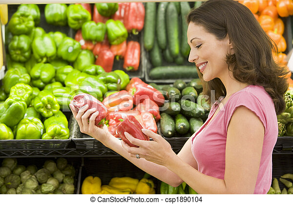 Woman shopping in produce section - csp1890104