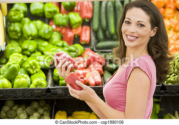 Woman shopping in produce section - csp1890106