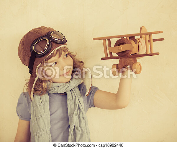 Happy kid playing with toy airplane - csp18902440